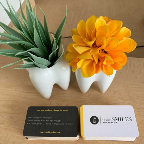 A photo of solidSMILES business cards on a table.